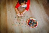 Child Making Geometric Shapes From Clay And Sticks, Engineering And Stem Education poster