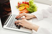 Female Nutritionist Working On Laptop In Office, Close Up. Hands Of Woman Dietitian Typing, Counting poster