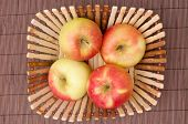 Apples in the punnet, on the mat