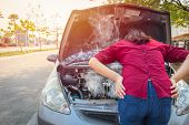 Asian Women Worry And Stress A Trouble With Car Engine Crash Overheat poster