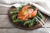 Fried Whole Chicken With Herbs Over Natural Wood Background. Whole Roasted Chicken poster