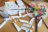 fine art, creativity and artistic tools concept - palette, brushes and paint tubes on table poster