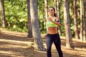 A Girl Jogging In The Woods Outdoors. Healthy Lifestyle. poster