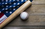 Baseball And Baseball Bat With American Flag On Wooden Table Background poster