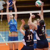 KAPOSVAR, HUNGARY - APRIL 24: Zsofia Harmath (3) blocks the ball at the Hungarian NB I. League woman volleyball game Kaposvar (blue) vs Ujbuda (black), April 24, 2011 in Kaposvar, Hungary.