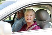 Senior citizen couple sitting in their car