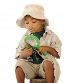 pic of glass frog  - An adorable preschooler in a safari hat and explorer clothes examining a frog - JPG