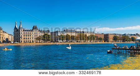 poster of Tourists Visiting And Enjoying Views Of Queen Louise Bridge And Peblinge Lake In Central Copenhagen