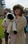 A puppeteer with a sheep performs on Exeter Cathedral Green