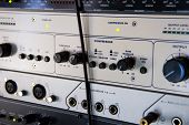 A Rack Of Audio Compressors In A Recording Studio. poster