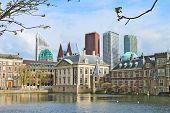Binnenhof Palace - Dutch Parlament Against The Backdrop Of Modern Buildings. Den Haag, Netherlands.