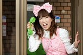 stock photo of lolita  - japanese lolita cosplay shouting in public phone - JPG