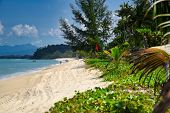 Waves Of The Azure Andaman Sea Under The Blue Sky Reaching The Shores Of The Sandy Beautiful Exotic poster