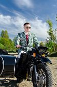 stock photo of sidecar  - Classy guy on a motorcycle with a sidecar - JPG