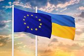 Relationship Between The European Union And The Ukraine. Two Flags Of Countries On Heaven With Sunse poster