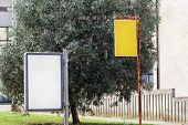Billboard And Yellow Advert Board In The Street City, Green Plants, Selective Focus And Closeup. Bla poster