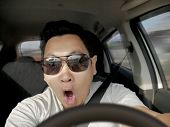 Portrait Of Male Asian Driver Shocked And Panic About To Have Crash Accident, Close Up With Open Mou poster