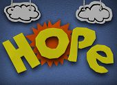A paper and cardboard cutout background with the word Hope in front of the sun with clouds in the sk
