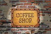 foto of oxidation  - Coffee shop painted sign on heavily rusted metal plate - JPG