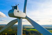 Wind turbine in Western Bohemia. Power plant with 2.0 MW output. Sustainable development and electri poster