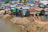 foto of overpopulation  - The poor area near the river in Phnom Penh Cambodia - JPG