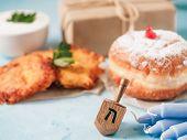 Jewish Holiday Hanukkah Concept And Background. Hanukkah Food Doughnuts And Potatoes Pancakes Latkes poster