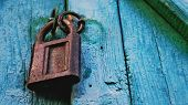 Old Lock Vintage Door Colorful Photo Close Up. Old Wooden Door Gate Closed With Metal Chain & Rusty  poster