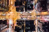 Car, Taxi, And Bus Traffic On Road Intersection At Night In Hong Kong Downtown District, Drone Aeria poster