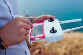 Drone Remote Control. Man Holding Copter Controller With Smartphone. Aerial Video Shooting poster