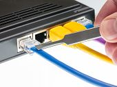 foto of cat5  - Close macro focus on internet lan cat5 cables as concept for cyberwarfare - JPG