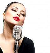 stock photo of singing  - Singing Woman with Retro Microphone - JPG