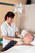 foto of infusion  - a nurse gives a patient an infusion - JPG