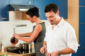 picture of crudites  - Man and woman in the kitchen  - JPG