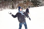 boy is throwing a snowball