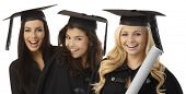 Closeup portrait of beautiful young female graduates in square academic cap smiling happy holding di