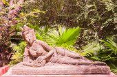 Sculpture of reclining fairy in botanic garden