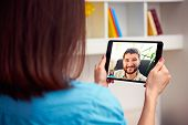 image of video chat  - man and woman communicating through video chat on tablet pc - JPG