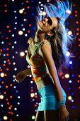 pic of night-club  - Beautiful blond female dancing in the club - JPG