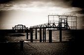 Remains Of The Old West Pier On Cold And Wet Day On Beach In Brighton, England, Uk