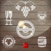 stock photo of merlot  - Stylized wine emblems on wooden background - JPG