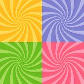 stock photo of swirly  - Set of swirly sunbursts in four bright colors - JPG