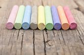 colorful chalks on old wooden table
