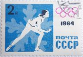 RUSSIA - CIRCA 1964: stamp printed by USSR shows Russian  Hockey player on Olympic Games 1964