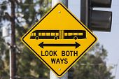 Look both ways bus and tram warning sign.