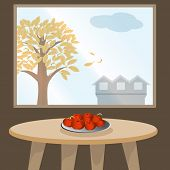 Apples on table by window