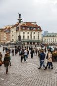 Tourists Visits Castle Square In Warsaw