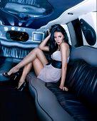 Beautiful girl in the limousine