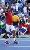 Professional tennis player Novak Djokovic celebrating victory after fourth round match US Open 2013