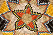 Colorful pattern on a hand woven African basket
