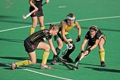 BLOEMFONTEIN, SOUTH AFRICA - FEBRUARY 7: A van Regemortel (L), L Deetlefs (M), G Valcke (R) during a women's field hockey match, South Africa vs. Belgium, Bloemfontein, South Africa, 7 February 2011